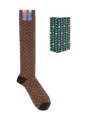 Immagine di calza lunga a pois fluo tamarindo