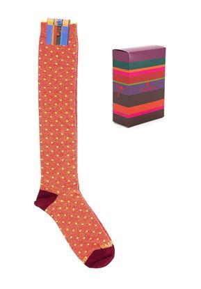 Immagine di calza lunga a pois fluo astice
