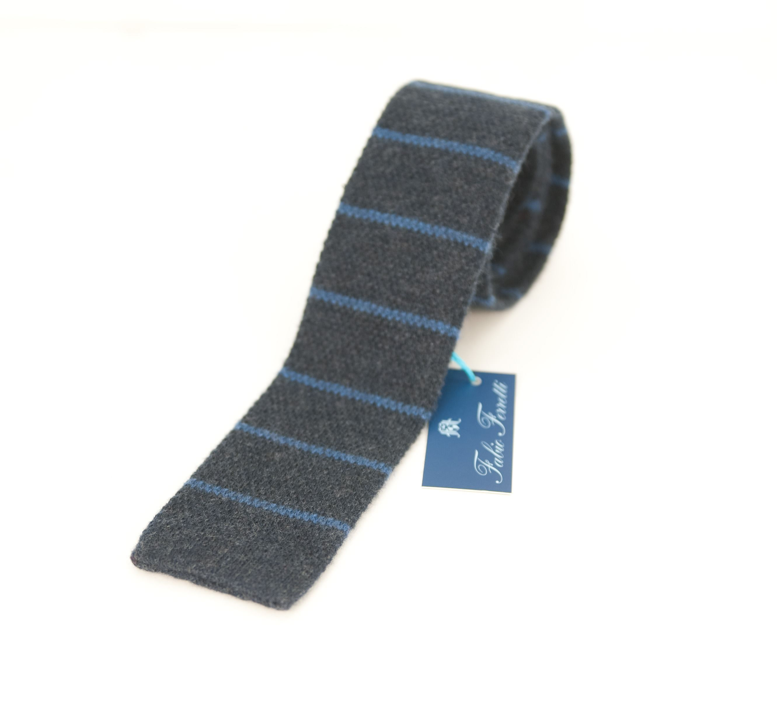 Picture of Knitted tie in blue background